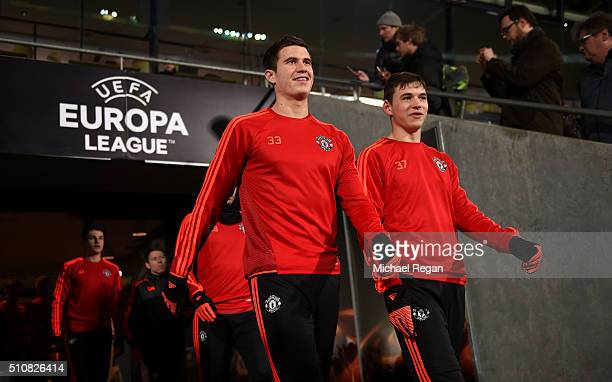 Paddy McNair and Donal Love of Manchester United make their way out onto the pitch during a training session ahead of the UEFA Europa League Round of...