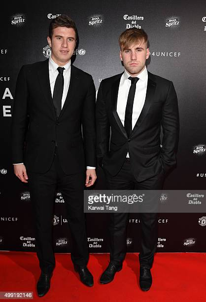 Paddy McNair and Luke Shaw attend the United for UNICEF Gala Dinner at Old Trafford on November 29 2015 in Manchester England