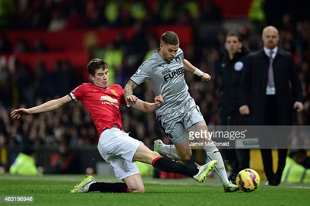 Paddy McNair of Manchester United tackles Michael Kightly of Burnley during the Barclays Premier League match between Manchester United and Burnley...