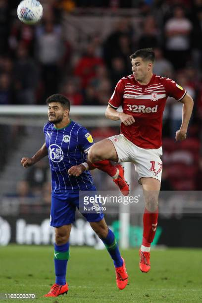 Paddy McNair of Middlesbrough contests a header with Sam Morsy Wigan Athletic during the Sky Bet Championship match between Middlesbrough and Wigan...