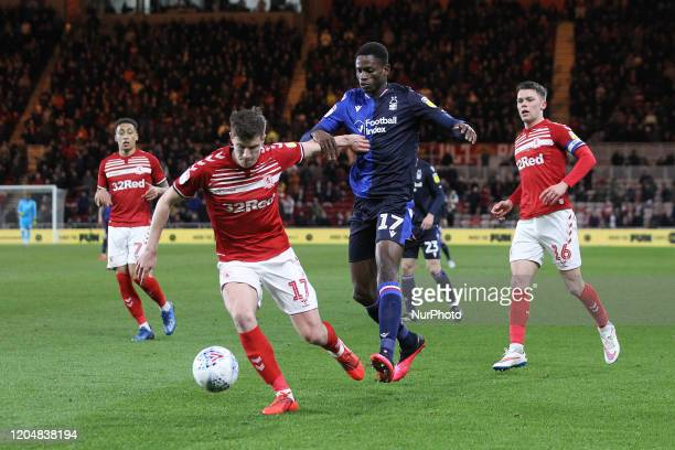 Paddy McNair of Middlesbrough in action with Alfa Semedo of Nottingham Forest during the Sky Bet Championship match between Middlesbrough and...