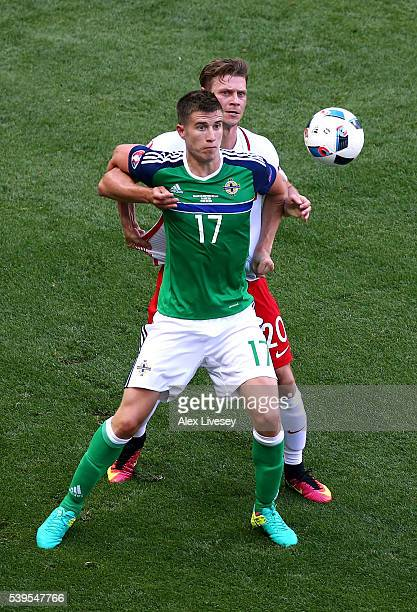 Paddy McNair of Northern Ireland controls the ball under pressure of Lukasz Piszczek of Poland during the UEFA EURO 2016 Group C match between Poland...