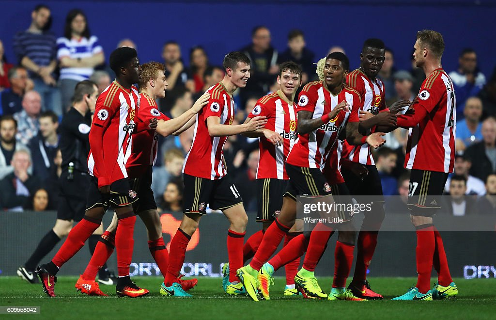 Paddy McNair of Sunderland celebrates scoring his sides second goal with team mates during the EFL Cup Third Round match between Queens Park Rangers and Sunderland at Loftus Road on September 21, 2016 in London, England.