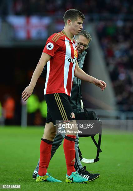 Paddy McNair of Sunderland is helped to his feet by the club physio after sustaining an injury during the Premier League match between Sunderland and...