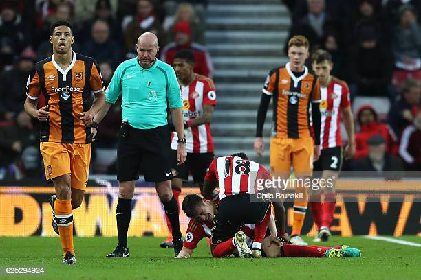 Paddy McNair of Sunderland lies injured as teammate Jermaine Defoe looks on during the Barclays Premier League match between Sunderland and Hull City...