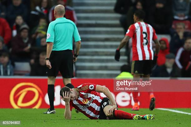 Paddy McNair of Sunderland lies injured during the Barclays Premier League match between Sunderland and Hull City at the Stadium of Light on November...