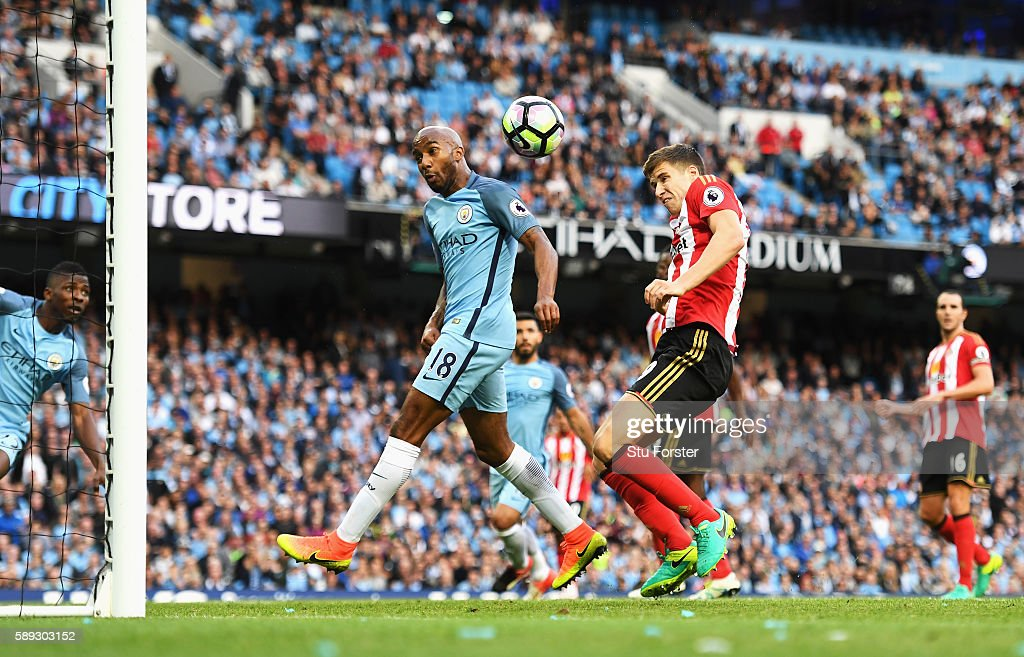 Paddy McNair of Sunderland scores a own goal for Manchester City's second goal during the Premier League match between Manchester City and Sunderland at Etihad Stadium on August 13, 2016 in Manchester, England.