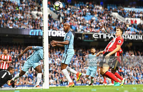 Paddy McNair of Sunderland scores a own goal to score Manchester City's second goal of the game during the Premier League match between Manchester...