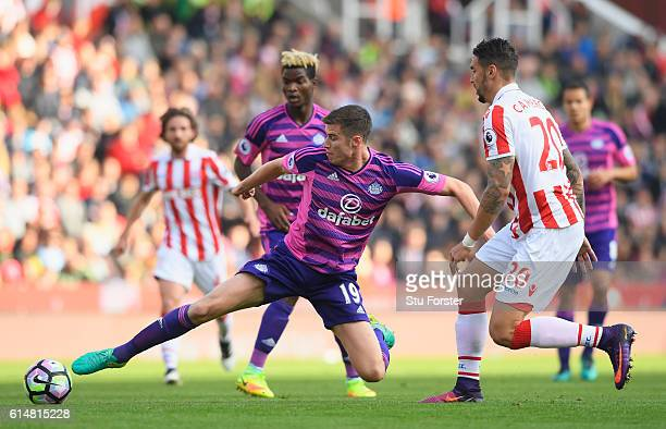 Paddy McNair of Sunderland stretches to reach the ball during the Premier League match between Stoke City and Sunderland at Bet365 Stadium on October...