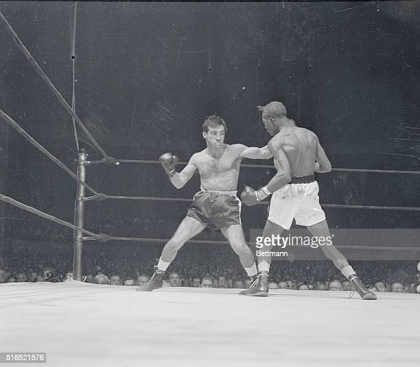 Paddy Pitches Em' Brooklyn's Paddy DeMarco viciously eyes lanky Sandy Saddler as he moves in to throw a right after shooting his left in second round...