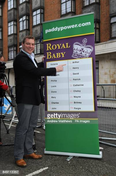 Paddy Power poses with a board of Royal baby names and their odds outside the King Edward VII hospital in London where the Duchess of Cambridge has...