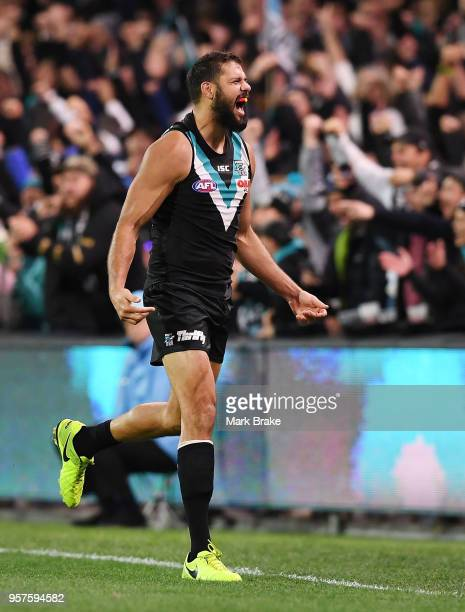 Paddy Ryder of Port Adelaide celebrates at the final siren during the round eight AFL match between the Port Adelaide Power and the Adelaide Crows at...