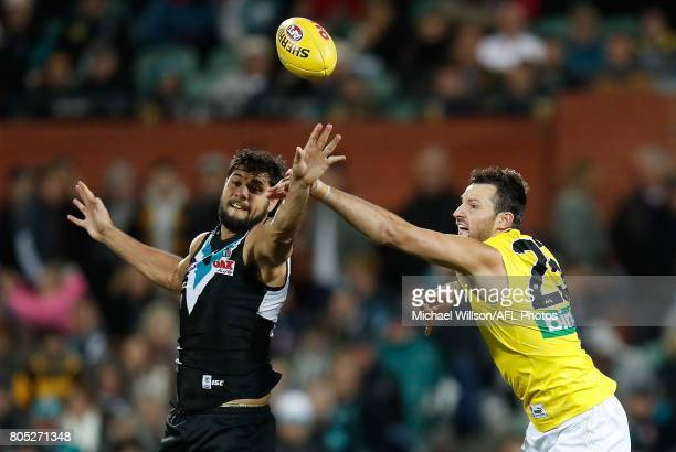 Paddy Ryder of the Power and Toby Nankervis of the Tigers compete in a ruck contest during the 2017 AFL round 15 match between the Port Adelaide...