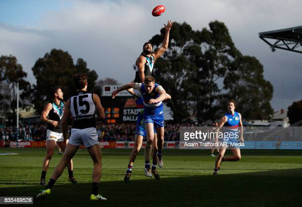 Paddy Ryder of the Power attempts to mark over Jordan Roughead of the Bulldogs during the 2017 AFL round 22 match between the Western Bulldogs and...