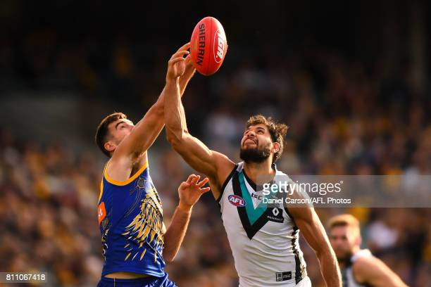 Paddy Ryder of the Power contests a boundary throw in against Scott Lycett of the Eagles during the 2017 AFL round 16 match between the West Coast...