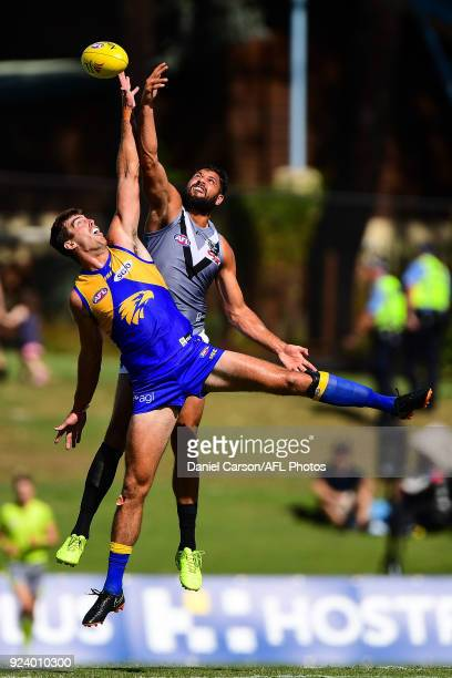 Paddy Ryder of the Power contests a ruck with Scott Lycett of the Eagles during the AFL 2018 JLT Community Series match between the West Coast Eagles...