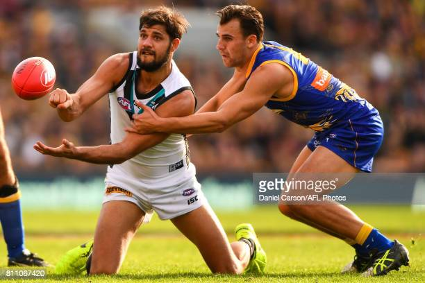 Paddy Ryder of the Power handpasses the ball during the 2017 AFL round 16 match between the West Coast Eagles and the Port Adelaide Power at Domain...