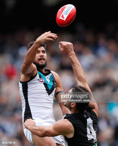 Paddy Ryder of the Power playing his 200th game and Brodie Grundy of the Magpies compete in a ruck contest during the 2017 AFL round 14 match between...