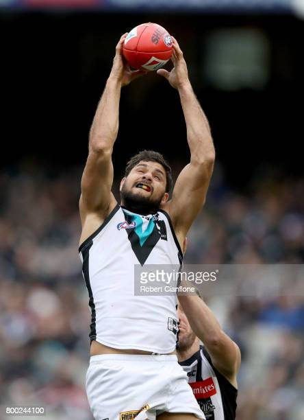 Paddy Ryder of the Power takes a mark during the round 14 AFL match between the Collingwood Magpies and the Port Adelaide Power at Melbourne Cricket...