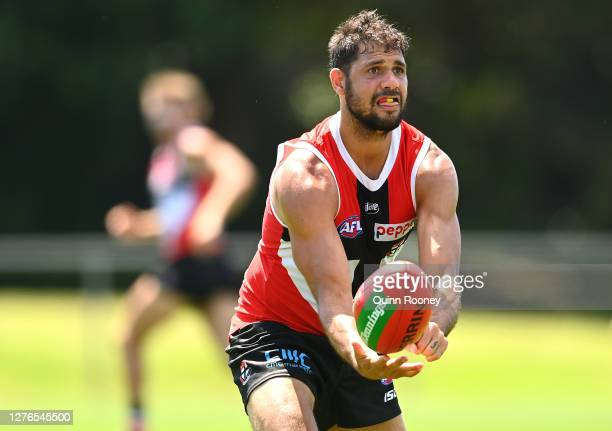 Paddy Ryder of the Saints handballs during a St Kilda Saints AFL training session at Maroochydore Multi Sport Complex on September 25 2020 in...