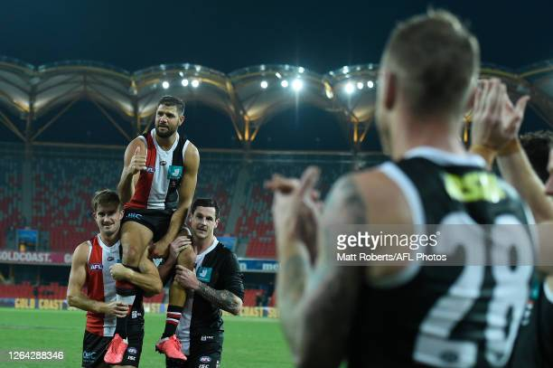 Paddy Ryder of the Saints is chaired from the field after his 250th match during the round 10 AFL match between the Gold Coast Suns and the St Kilda...