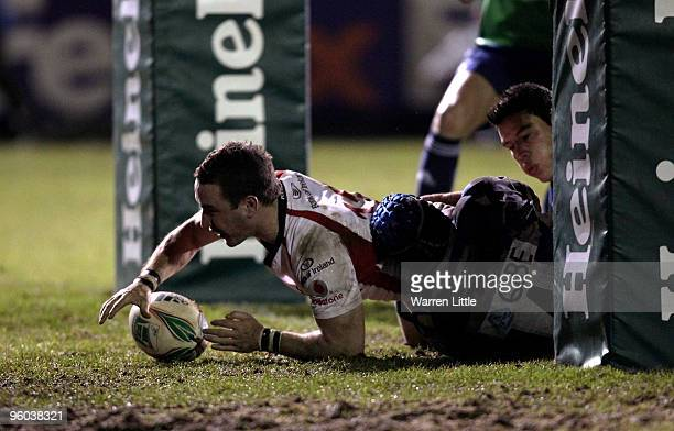 Paddy Wallace of Ulster dives over to score a try during the Heineken Cup round six match between Bath Rugby and Uslter Rugby at the Recreation...
