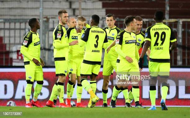 Paderborn 07 players celebrate after their side's first goal, an own goal scored by James Lawrence of FC St. Pauli during the Second Bundesliga match...
