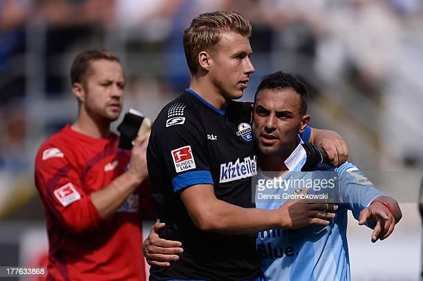 Paderborn players Rick Ten Voorde and Mahir Saglik celebrate after the Second Bundesliga match between SC Paderborn and TSV 1860 Muenchen at Benteler...
