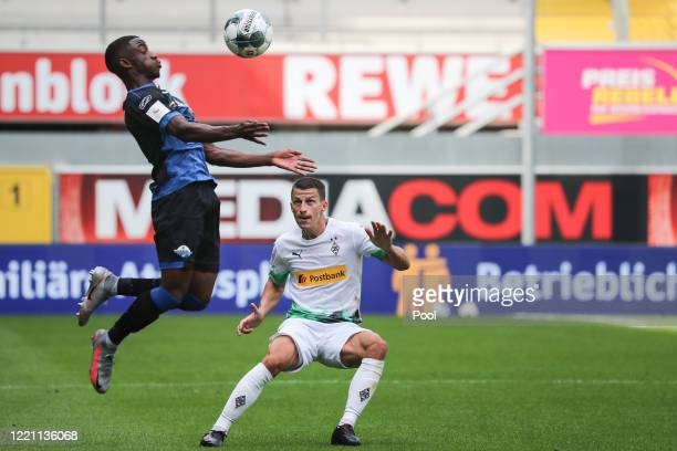 Paderborn's Christopher AntwiAdjei in action against Moenchengladbach's Stefan Lainer during the Bundesliga match between SC Paderborn 07 and...