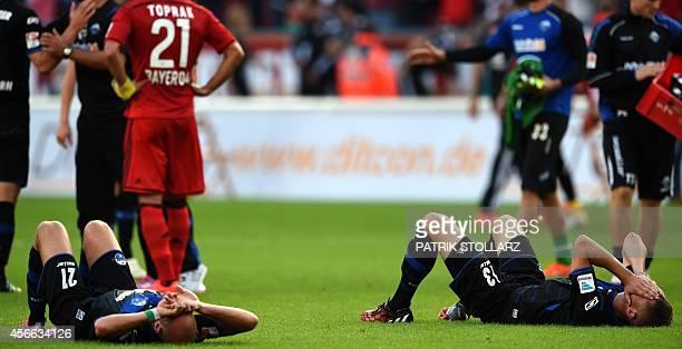 Paderborn's defender Christian Strohidek and Paderborn's midfielder Daniel Brueckner react after the German first division Bundesliga football match...
