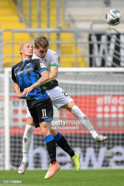 Paderborn's German forward Sven Michel and Moenchengladbach's German defender Matthias Ginter vie for the ball during the German first division...