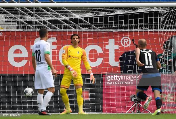Paderborn's German forward Sven Michel scores past Moenchengladbach's Swiss goalkeeper Yann Sommer during the German first division Bundesliga...