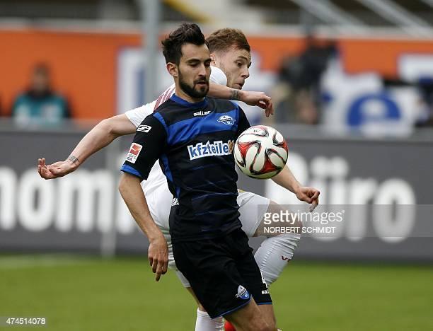 Paderborn's midfielder Lukas Rupp and Stuttgart's Rumanian midfielder Alexandru Maxim vie for the ball during the German first division Bundesliga...