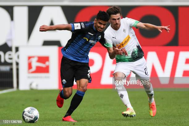 Paderborn's Mohamed Draeger in action against Moenchengladbach's Jonas Hofmann during the Bundesliga match between SC Paderborn 07 and Borussia...