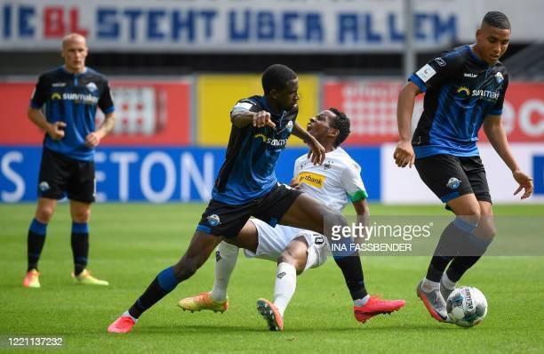 Paderborn's Nigerian defender Jamillu Collins Moenchengladbach's French forward Marcus Thuram and Paderborn's German midfielder Christopher...