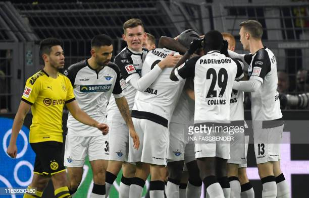 Paderborn's players celebrate after scoring the 01 during the German first division Bundesliga football match Borussia Dortmund v SC Paderborn in...