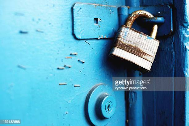 padlock and entry locks on blue door - door lock stock pictures, royalty-free photos & images