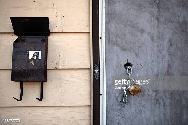 A padlock hangs from a door of a foreclosed home on February 9 2012 in Islip New York A New York State Department of Financial Services Foreclosure...