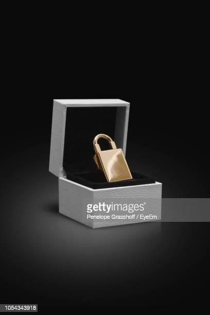 padlock in box on black background - jewelry box stock pictures, royalty-free photos & images