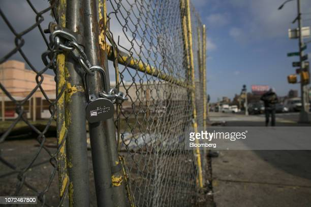 Padlock is seen on a fence surrounding an abandoned lot, where East Harlem Media Entertainment and Cultural Center is planned to be built, in the...