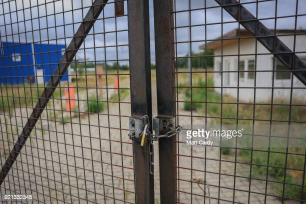 A padlock locks the gates of the old migrant reception centre on July 16 2016 in Roszke Hungary Last summer thousands of refugees and migrants were...