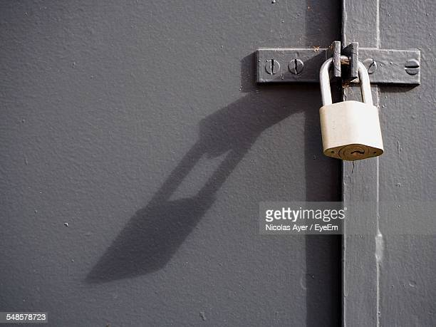 Padlock On Closed Metal Door