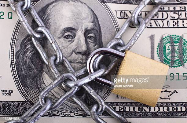 padlock on hundred dollar bill - protection stock pictures, royalty-free photos & images