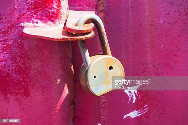 padlock on metal door