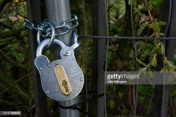 Padlock on the fence of an outdoor gym area at Primrose Hill closed due to the contamination risk of Covid-19 on March 25, 2020 in London, United...