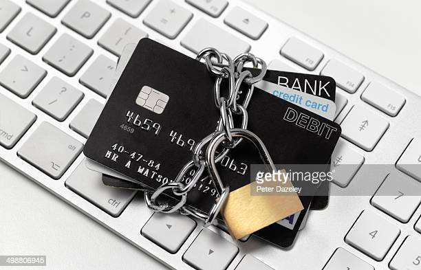 padlocked credit card of keyboard - identity theft stock pictures, royalty-free photos & images