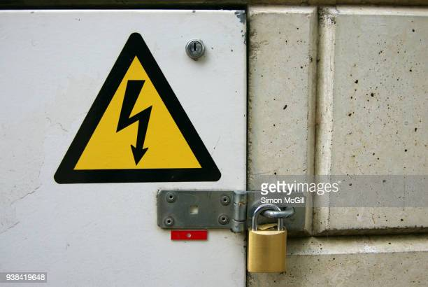 padlocked high voltage electrical equipment box - electrical box stock pictures, royalty-free photos & images