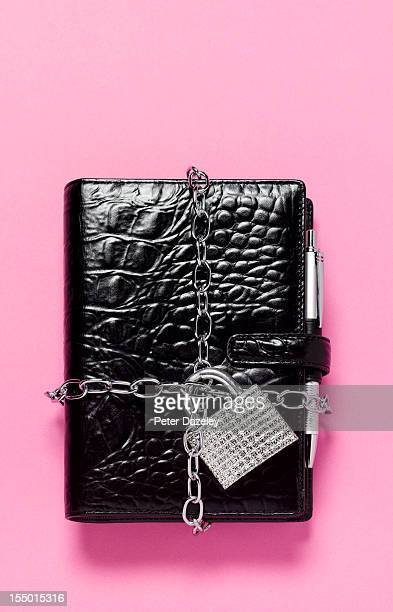 Padlocked little black book or diary