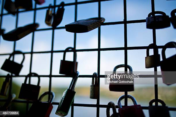 Padlocks of loving couples at the dam of Moehne River of Moehnesee near Guenne on August 06 2015 in Guenne Germany