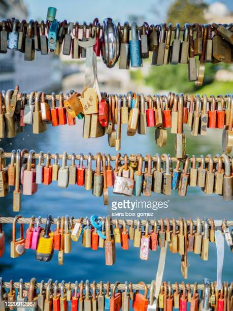 padlocks on a bridge over the river ljubljanica - slovenia stock pictures, royalty-free photos & images